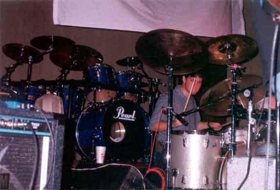 Hugh playing the drums pretending he's in Pink Floyd