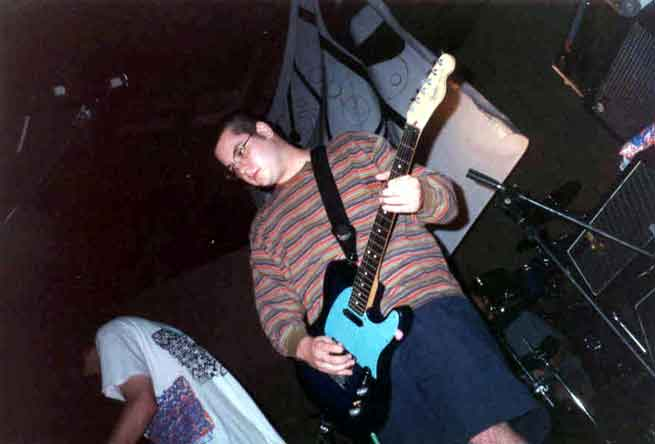 This is a picture of Jason playing guitar very well.